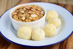India suji  Halwa and coconut truffles. India suji Halwa(pudding) made from semolina,butter and Sugar Royalty Free Stock Photo