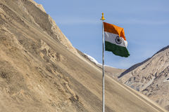 India symbol indian flag against mountains and blue sky Stock Photos