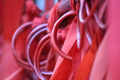 India temple bangle with red cloth. Devotional red cloth with bangle use for wish at temple in India stock photography