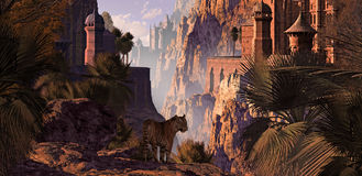 India And The Tiger. A landscape in India of a mountainous canyon with gothic castles, date palms and a Bengal tiger Stock Photo