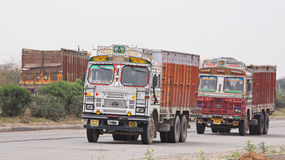 India Trucks. RAJASTHAN, INDIA - MARCH 26, 2014: Trucks on the Jaipur to Delhi state  highway. India has the second largest network of roads in the world and its Royalty Free Stock Photos