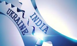 India Ukraine - Text on the Mechanism of Metallic Gears. 3D. Royalty Free Stock Photos