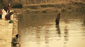India, varanasi, people bathing in ganges river stock video footage
