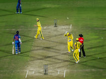 India versus Australia cricket. Brad Haddin takes cover from a ball thrown in his direction: a scene from the One Day international cricket match played at stock photos