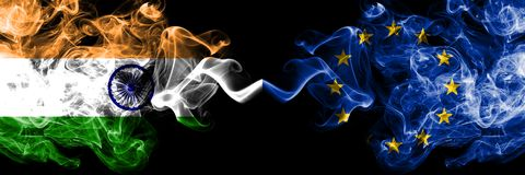 India vs European Union, EU smoke flags placed side by side. Thick colored silky smoke flags of Indian and European Union, EU.  stock images