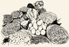 India - woman selling fruit and vegetable in a mar Royalty Free Stock Image