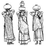 India, women carrying jars on their head Royalty Free Stock Photos