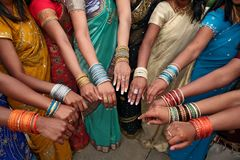 India women in dresses and wrist jewelry. India women in colorful dresses and wrist jewelry of many colors Royalty Free Stock Photography