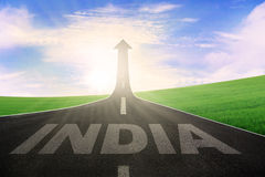 India word with an arrow upward on road Stock Photography
