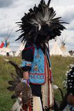 Indian. Chief with a headdres in tipi village Royalty Free Stock Photos