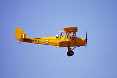 Indian Air Force Tiger Moth flying at Aero India royalty free stock image