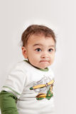 Indian angry baby boy. Indian angry and unhappy baby boyd looking at the camera on white background Royalty Free Stock Photos