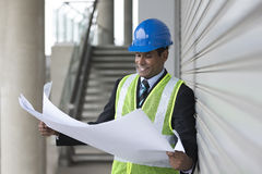Indian Architect or industrial engineer at work. Royalty Free Stock Image