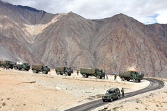 Indian army convoy of trucks. JAMMU & KASHMIR, INDIA - SEPTEMBER 04, 2011: Indian army convoy of trucks delivering supplies to remote military installations in Stock Photography