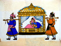 Indian Art. A beautiful traditional Indian painting on the palace walls. The painting is about a queen been transported by the guards from one place to the other Royalty Free Stock Photography