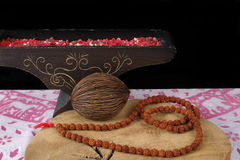 Indian art - prayer beards from Rudraksha on teak wood and backg Royalty Free Stock Images