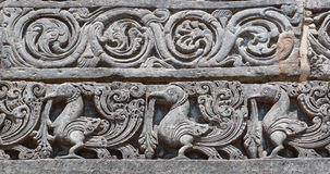 Indian artwork on the Hindu temple walls with mythical swans. 12th centur Hoysaleshwara temple in Halebidu, India. Royalty Free Stock Images
