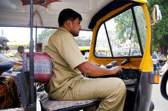 Indian Auto rickshaw driver Stock Photo