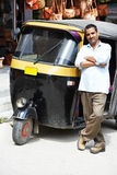 Indian auto rickshaw tut-tuk driver man. Indian auto rickshaw three-weeler tuk-tuk taxi driver man Stock Photo