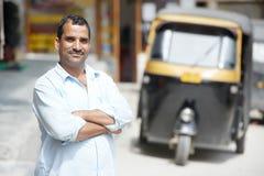 Indian auto rickshaw tut-tuk driver man. Indian auto rickshaw three-weeler tuk-tuk taxi driver man Stock Photography