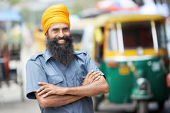 Indian auto rickshaw tut-tuk driver man. Indian auto rickshaw three-weeler tuk-tuk taxi driver man Stock Image