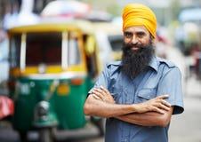Indian auto rickshaw tut-tuk driver man. Indian auto rickshaw three-weeler tuk-tuk taxi driver man Royalty Free Stock Photos