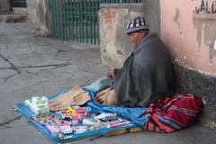 Indian Aymara woman sells in street, La Paz, Bolivia. Indian Aymara woman sells hygiene items and other little things in a street of La Paz, Bolivia, South Royalty Free Stock Photo