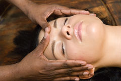 Indian ayurvedic oil face massage Stock Images
