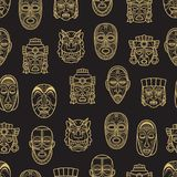 Indian aztec and african historic tribal mask seamless pattern. Gold indian aztec and african historic tribal mask seamless pattern background. Vector royalty free illustration