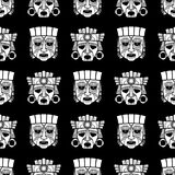Indian aztec and african tribal vodoo mask seamless pattern. Indian aztec and african historic tribal vodoo mask black white seamless pattern. Vector Stock Photo
