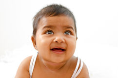 Indian baby girl looking up Royalty Free Stock Photo