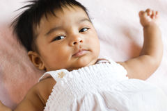 Indian Baby with Wary Expression. Skeptical and wary expression on this beautiful ethnic Asian child Stock Image