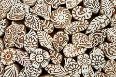 Indian background. Leaf, flower, patterns, sun symbols on wooden texture of print blocks, for asian textile clothing Stock Photos