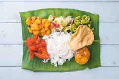 Indian banana leaf rice on table Stock Photo
