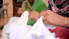 Indian bandhani cloth making process stock footage