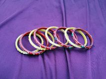 Indian  Bangles.  many color bangles on violet background royalty free stock photos