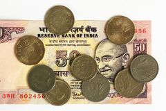 Indian bank note and coins Stock Images