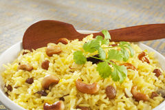 Indian Basmati Rice Pilau Close-up. Classic fruit and nut Indian pilau, basmati rice cooked with stock, saffron, garlic, onion, cinnamon, cardamom, sultanas and Stock Image