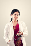 Indian beautiful female doctor. Indian beautiful Friendly lady doctor with stethoscope in sari stock photography