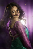 Indian Beautiful girl dancing in studio background. Royalty Free Stock Images