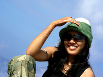 Indian Beauty. On vacation in the Sun wearing a woolen cap Stock Image