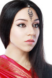 Indian beauty. Face close up perfect make up. Series. young beautiful brunette in traditional national dress Royalty Free Stock Image