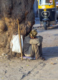 Indian beggar seeking for charity on the street Royalty Free Stock Images