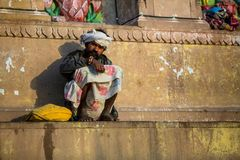 Indian beggar sitting on the street. Stock Image