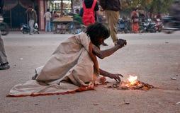 Indian beggar at street in winter