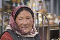 Indian beggar woman on the street in Leh, Ladakh. India Stock Photography