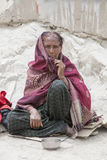 Indian beggar woman on the street in Leh, Ladakh. India Royalty Free Stock Photography