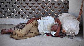 Indian begger. Sleeping on the side of the road at hoshiarpur town in punjab india stock image