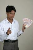 Indian bem sucedido com moeda indiana Fotografia de Stock Royalty Free