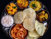 Indian Bengali Thali. Indian meal (Thali) consisting of different curry,flat bread,rice and papad Stock Photos